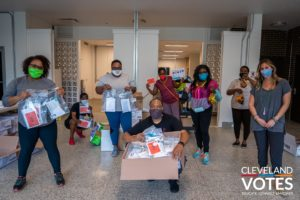 Cleveland VOTES team wearing and sharing masks